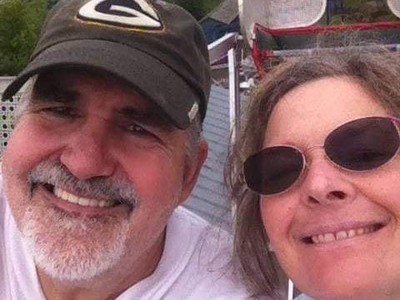 Milwaukee residents John Spirewka and April Hill both have relatives in Wisconsin and elsewhere who don't want to be vaccinated against COVID-19 despite pleas from family members. Shown in this 2017 photo, Spirewka and Hill relax at Little Amerricka Amusement Park in Marshall. Photo courtesy of John Spirewka/WPR.