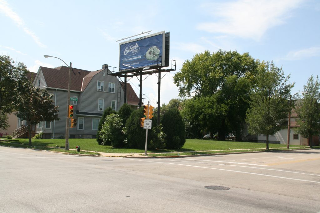 1701 W. State St. (billboard) and development site at 1703-1719 W. State St. Photo by Jeramey Jannene.