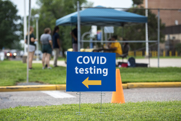 A sign points to a location on UW-Eau Claire's campus where students can be tested for COVID-19 on Saturday Aug. 28, 2021. Angela Major/WPR