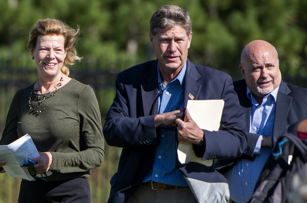 U.S. Sen. Tammy Baldwin, left, U.S. Rep. Ron Kind, center, and U.S. Rep. Mark Pocan, right, hold notes as they walk up to address reporters Tuesday, Sept. 7, 2021, at Fort McCoy between Sparta and Tomah, Wis. Angela Major/WPR