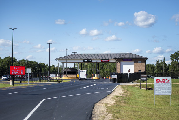 Vehicles pass through the main gate Tuesday, Sept. 7, 2021, at Fort McCoy between Sparta and Tomah, Wis. Angela Major/WPR