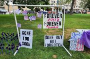 Visitors hung notes on a display at the International Overdose Awareness Day memorial event at Zeidler Union Square in downtown Milwaukee. Photo by Edgar Mendez/NNS.