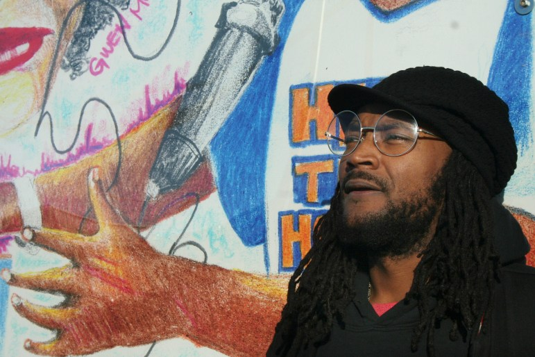 jamou Butler has worked in Wisconsin schools for 10 years for Heal the Hood MKE and as a private consultant. He says police are not necessarily the best equipped to handle trauma and mental health problems that underlie some school violence. He is seen here beside a mural in the Harambee neighborhood in Milwaukee on Dec. 9, 2016. jabril yousef faraj / Milwaukee Neighborhood News Service
