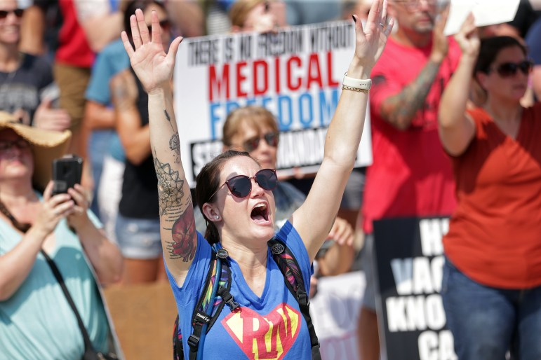 Aurora St. Luke's Medical Center emergency room nurse Devin Hart of Milwaukee reacts to a speech during an Aug. 10, 2021 protest against vaccine mandates for health care employees on the steps of the state Capitol in Madison. Credit: Kayla Wolf / Wisconsin State Journal