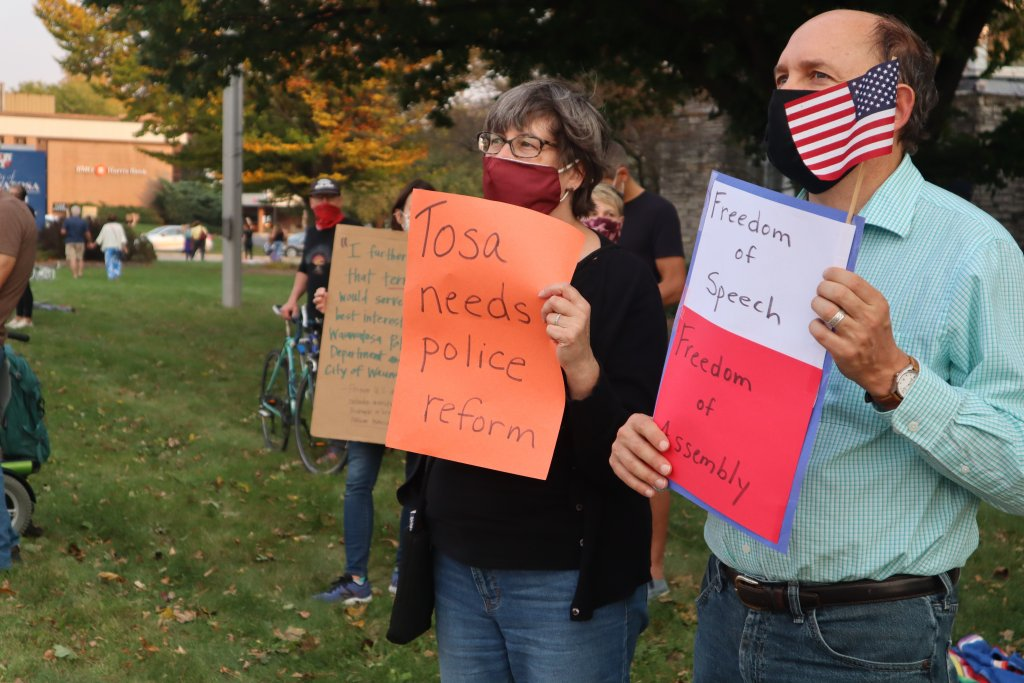 Wauwatosa residents stand outside city hall as curfew approaches. Photo by Isiah Holmes/Wisconsin Examiner.