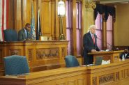 Mayor Tom Barrett delivers his 2022 budget to the Milwaukee Common Council as Council President Cavalier Johnson looks on. Photo by Jeramey Jannene.