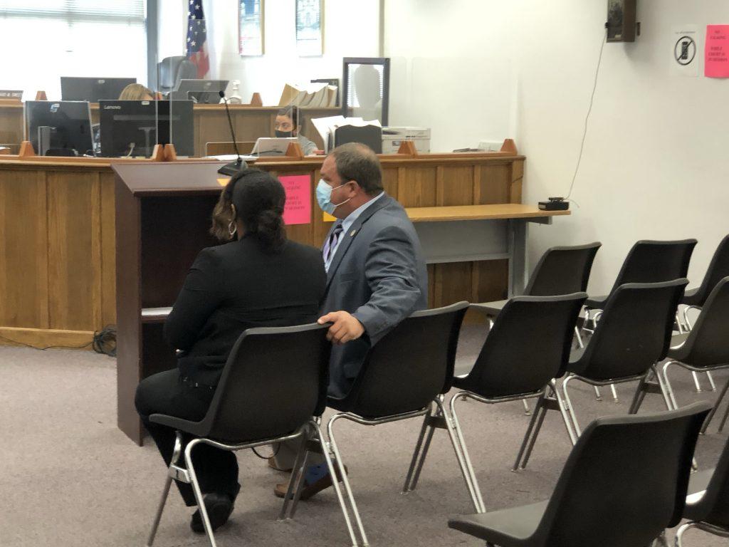 Ald. Chantia Lewis confers with attorney Michael Maistelman before intake court hearing. Photo by Jeramey Jannene.