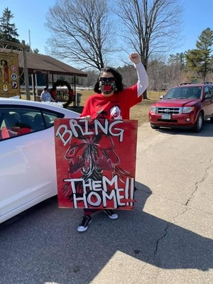 Rachel Fernandez, a member of the Menominee Nation and the MMIW Task Force, at a pop-up protest in downtown Keshena. Photo Courtesy Rachel Fernandez/WPR.