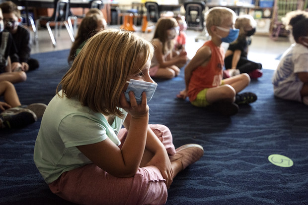 First-graders wear face masks as they sit during a lesson Friday, Sept. 17, 2021, at Hackett Elementary School in Beloit, Wis. Angela Major/WPR