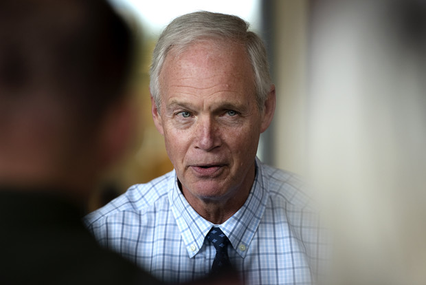 Sen. Ron Johnson speaks to reporters after a town hall Friday, Oct. 8, 2021, at Boulder Junction Town Hall in Boulder Junction, Wis. Angela Major/WPR