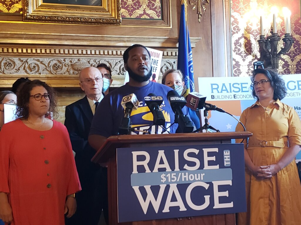 James Rudd speaks in favor of a bill to increase Wisconsin's minimum wage at a Capitol press conference June 17 with Sen. Melissa Agard, right, the bill's author. Photo by Erik Gunn/Wisconsin Examiner.
